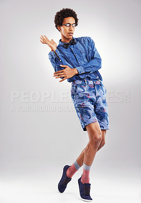 Buy stock photo Studio shot of a stylishly dressed young man against a gray background
