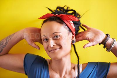 Buy stock photo Portrait of an attractive woman with dreadlocks standing against a yellow background