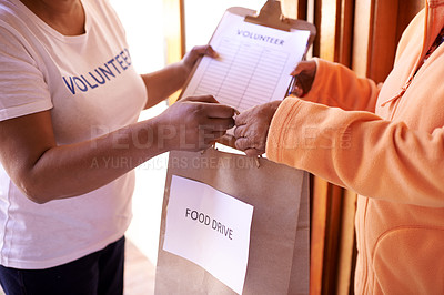Buy stock photo Cropped shot of a volunteer helping a person in need