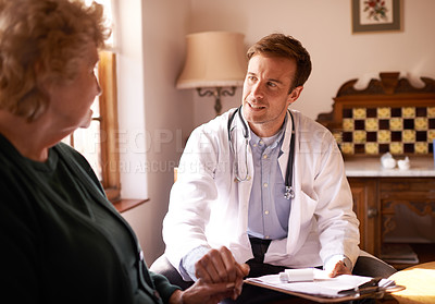 Buy stock photo Shot of a doctor talking to a senior patient at a retirement home