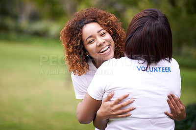 Buy stock photo Cropped shot of two volunteer workers hugging outside