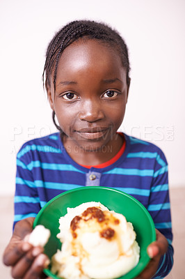 Buy stock photo Shot of a young girl offering you some of her food