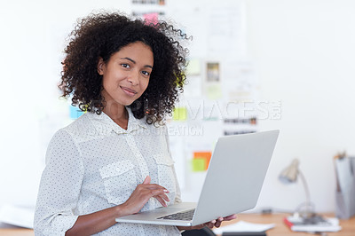 Buy stock photo Portrait of a young designer working on her laptop in an office