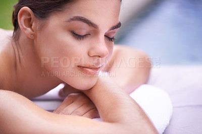 Buy stock photo Shot of a young woman lying on a spa bed