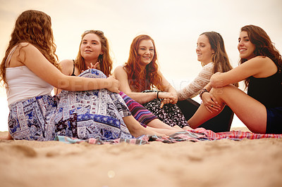 Buy stock photo Shot of a group of girlfriends spending time together outdoors