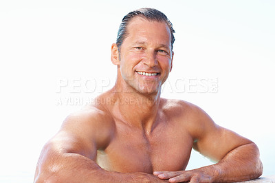 Buy stock photo Portrait of smiling man in the swimming pool relaxing with hands on ledge