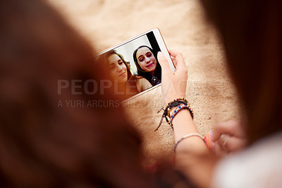 Buy stock photo Cropped shot of friends looking at photos on a digital tablet