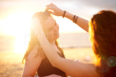 Buy stock photo Shot of affectionate girlfriends spending time together outdoors