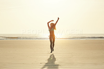 Buy stock photo Portrait of an attractive young woman running on the beach