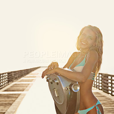 Buy stock photo Shot of a young woman standing by a binocular