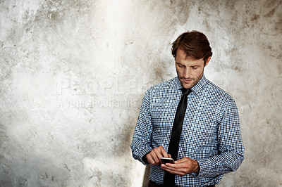 Buy stock photo Studio shot of a businessman using a cellphone