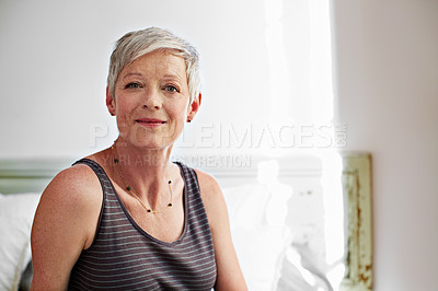 Buy stock photo Portrait of a smiling mature woman at home