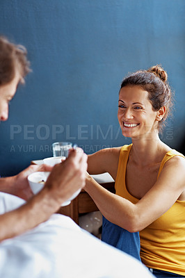 Buy stock photo Shot of a content couple having breakfast in their bedroom