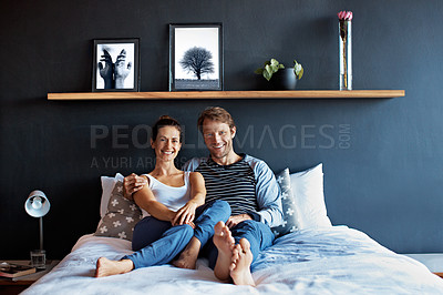 Buy stock photo Portrait of a content mature couple sitting on their bed together
