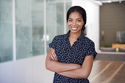 Buy stock photo Portrait of a smiling young woman standing with her arms crossed at home