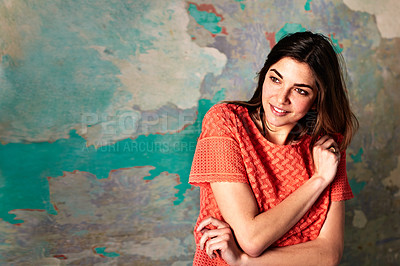 Buy stock photo Shot of a smiling young woman standing in front of a a peeling wall