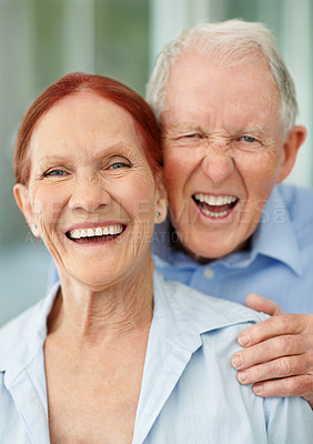 Buy stock photo Portrait of a happy senior couple laughing together