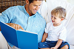 Father reading a story to his son