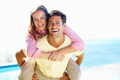 Buy stock photo Portrait of man giving a piggyback ride to woman