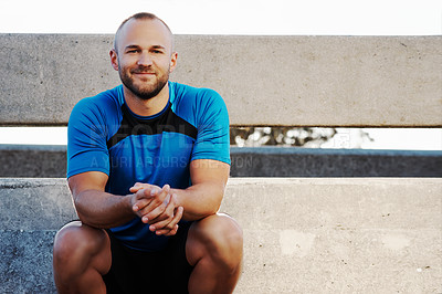 Buy stock photo Cropped portrait of an athletic man taking a break from his run in the city