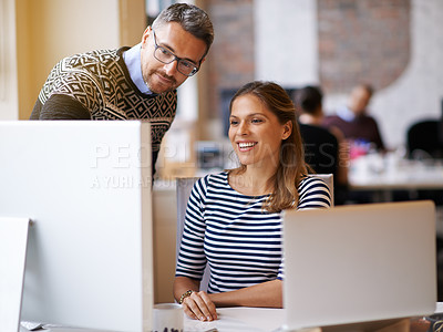Buy stock photo Shot of two designers working together at a computer