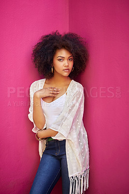 Buy stock photo Portrait of an attractive young woman posing against a pink background