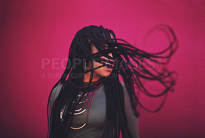 Buy stock photo Shot of a young woman with braids posing against a pink background