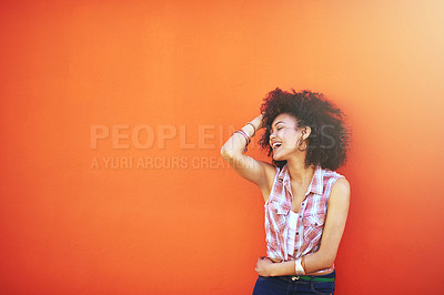Buy stock photo Shot of an attractive young woman posing against a colorful background