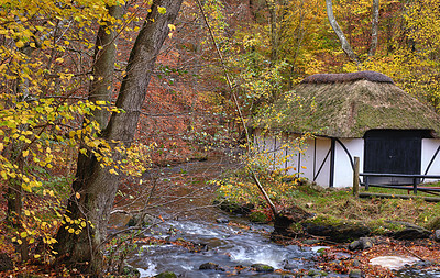 Buy stock photo 250 years old public fishing house by the river  in the colors of autumn