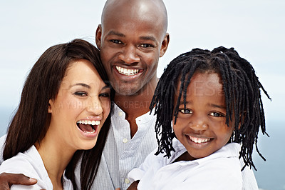 Buy stock photo Portrait of a laughing young family standing outside