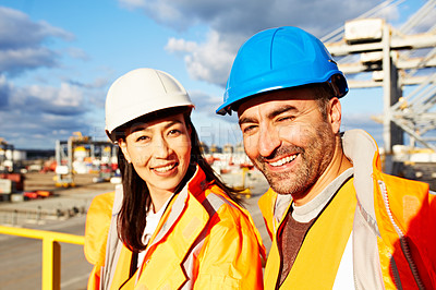 Buy stock photo Portrait of a two workers standing on a large commercial dock