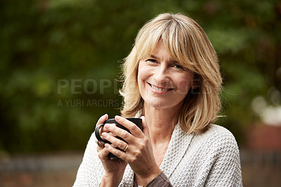 Buy stock photo Portrait of a mature woman standing in her yard drinking a cup of coffee