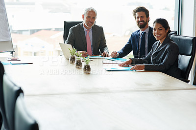 Buy stock photo Shot of a group of executives having a meeting in a boardroom