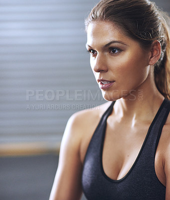 Buy stock photo Cropped shot of a fit young woman at the gym