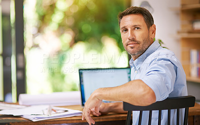 Buy stock photo Shot of a young man working from home