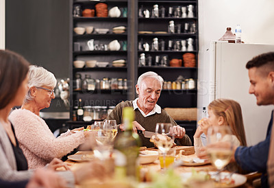 Buy stock photo Cropped shot of a family sitting down to dinner