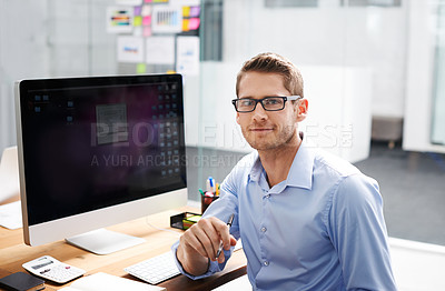 Buy stock photo Portrait of a businessman working on his office computer