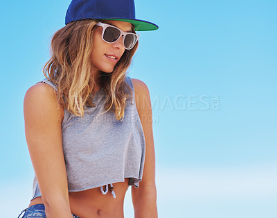 Buy stock photo Shot of a young woman enjoying a day outside
