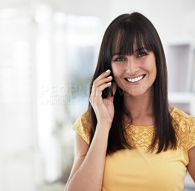 Buy stock photo Cropped portrait of a woman using her cellphone at home