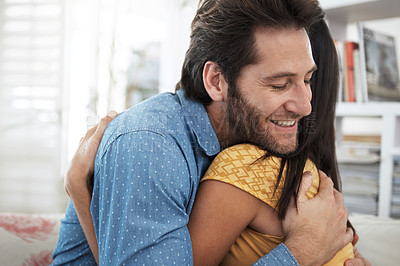 Buy stock photo Cropped shot of a couple embracing at home