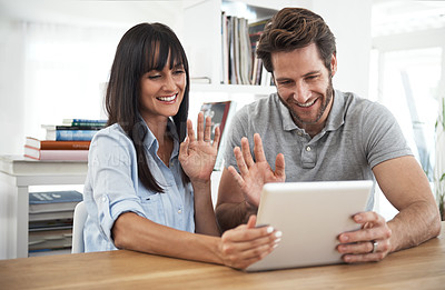 Buy stock photo Cropped shot of a couple using a digital tablet to chat online