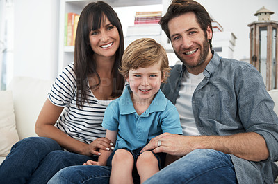 Buy stock photo Portrait of a little boy sitting with his mother and father at home
