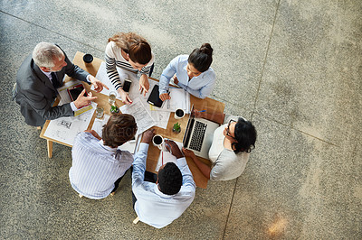 Buy stock photo High angle shot of a group of coworkers sitting around in a circle