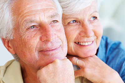 Buy stock photo Closeup of happy senior couple smiling and looking away