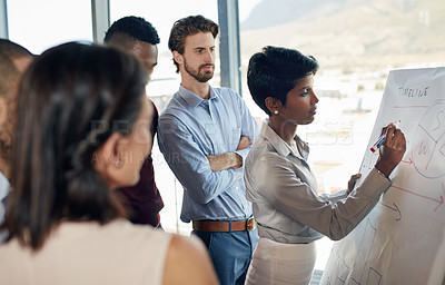 Buy stock photo Cropped shot of a businesswoman giving a presentation