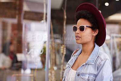 Buy stock photo Cropped shot of a young woman shopping in a clothing store