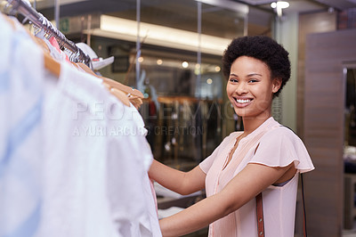 Buy stock photo Cropped portrait of a young woman shopping in a clothing store