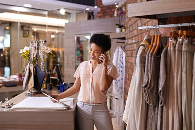 Buy stock photo Cropped shot of a young woman taking clothing orders over the phone