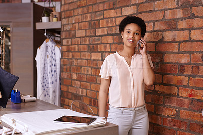 Buy stock photo Cropped portrait of a young woman taking clothing orders over the phone