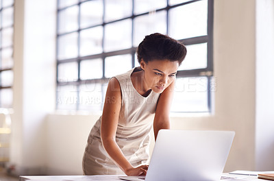 Buy stock photo Shot of a businesswoman working on her laptop